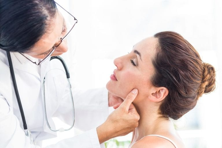 Doctor examining a womans face