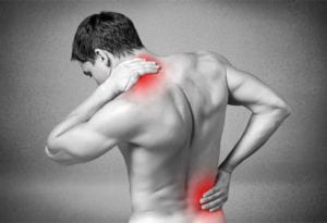 Man experiencing necl and lower back pain from Polymyositis